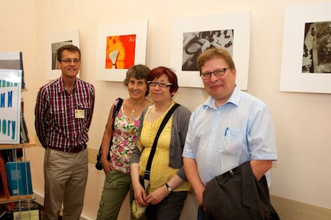 "Left to right: Paul Ogden & spouse (Director, Paul Ogden Consulting), Carol Brown (Watkins Brown) and Ejnar Stig Askgård (Chief Curator, Hans Christian Andersen Museum) at the ""Best Books of Russia"" exhibition at the Chekhov Library"