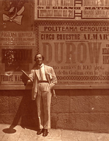Anatoly Durov with his posters on the background in Genova, Italy (1922)